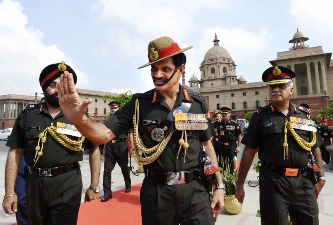 New Army Chief General Dalbir Singh Suhag arrives to inspect a guard of honour at South Block in New Delhi on Friday