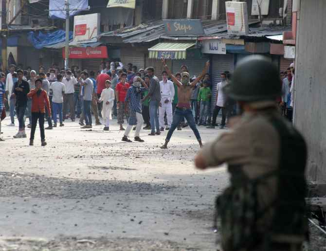 Protestors clash with police in Srinagar on Friday