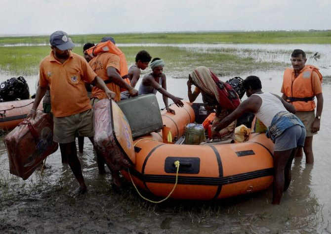NDRF jawans rescue flood affected villagers near the Indo- Nepal border at Birpur.