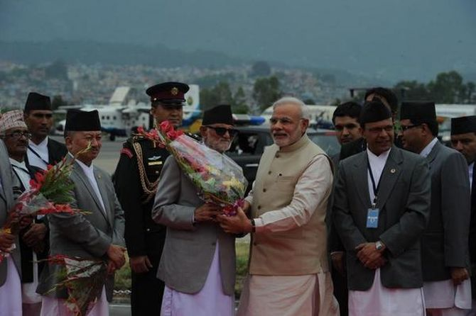 PM Modi is warmly welcomed by Nepal PM Sushil Koirala at the Tribhuvan International Airport.