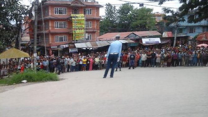 Locals in Nepal welcome Modi as he makes his way into the country from the airport.