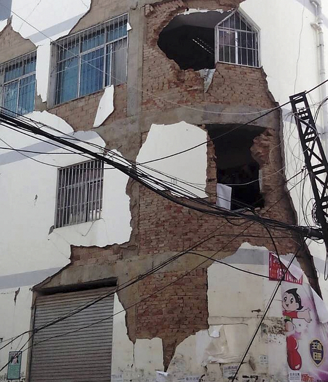 A building is damaged after an earthquake hit Ludian county, Yunnan province