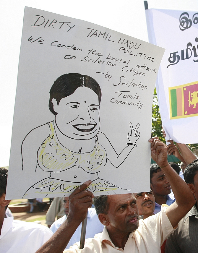embers from the Sri Lankan Tamil community shout slogans against the state government