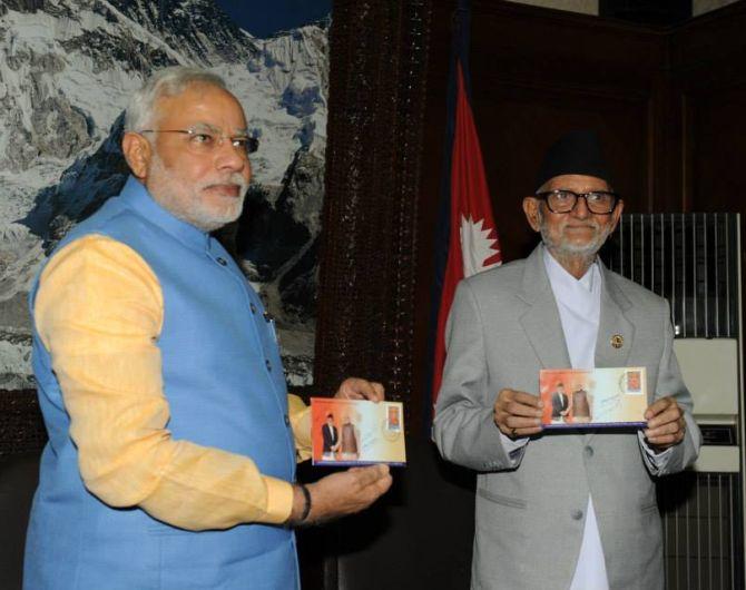 PM Modi and Nepal PM Sushil Koirala launch a new commemorative stamp