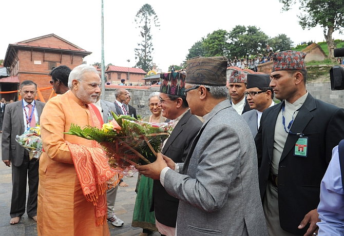 Modi is greeted as he arrives at the temple