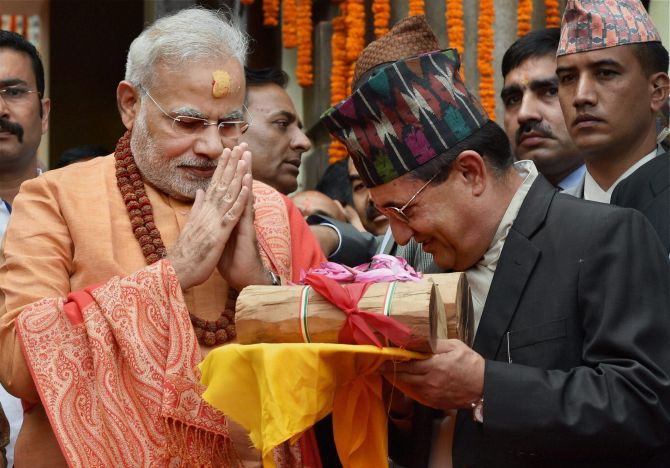 Prime Minister Narendra Modi gifts sandalwood to the Pashupatinath temple after praying at the temple.