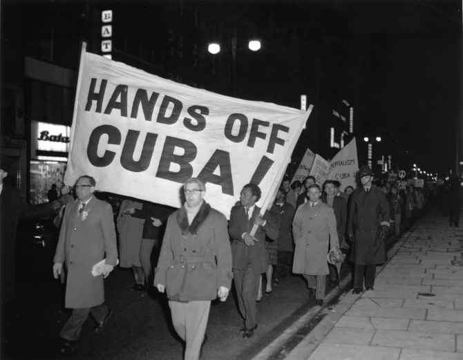 Peace activists protesting against US action in Cuba participate in a march in London in this 1962 photograph.