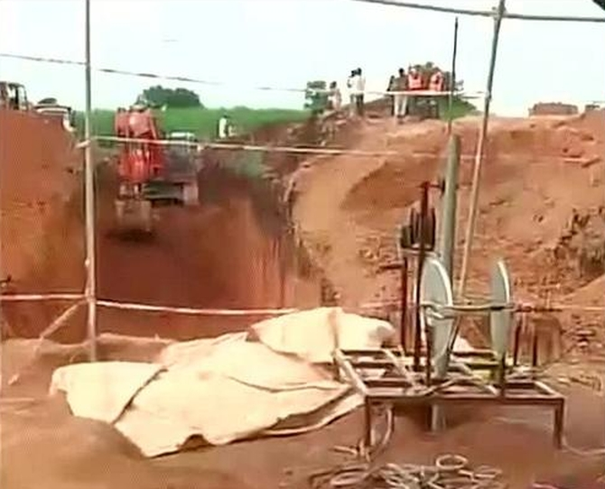 PICS: Rescuers race against time to save boy stuck in borewell