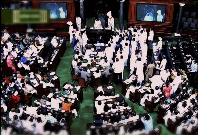 Congress members storm the Well in the Lok Sabha demanding a discussion on communal tension in the country
