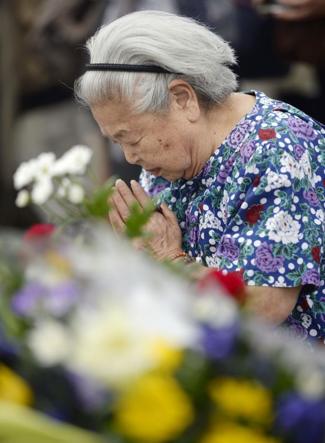 PHOTOS: 69 years after world's DEADLIEST attack