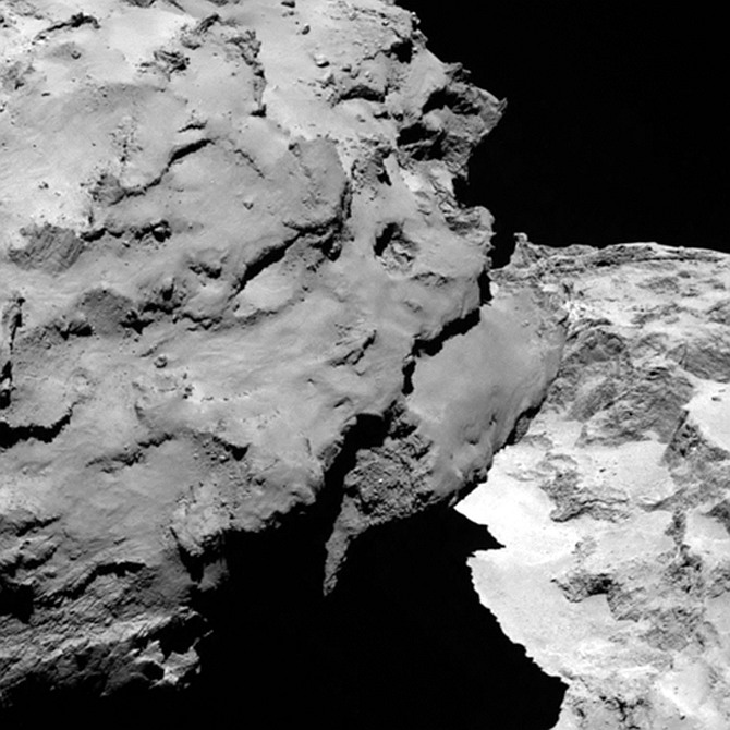 Close-up detail of comet 67P/Churyumov-Gerasimenko. The image was taken by Rosetta's OSIRIS narrow-angle camera and downloaded on August 6. The image shows the comet's 'head' at the left of the frame, which is casting shadow onto the 'neck' and 'body' to the right. The image was taken from a distance of 120 km and the image resolution is 2.2 metres per pixel.