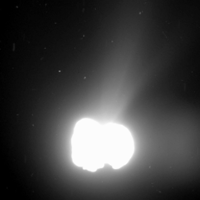 Comet 67P/Churyumov-Gerasimenko activity on 2 August 2014. The image was taken by Rosetta's OSIRIS wide-angle camera from a distance of 550 km. The exposure time of the image was 330 seconds and the comet nucleus is saturated to bring out the detail of the comet activity. Note there is a ghost image to the right. The image resolution is 55 metres per pixel.
