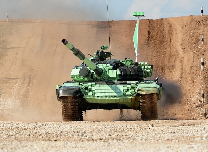The Serbian tank crew clears an obstacle