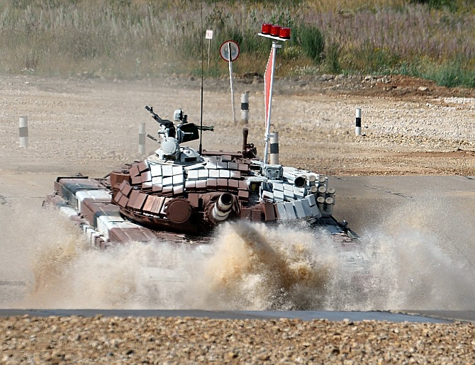 Mongolian tank crew competes at the tank biathlon outside Moscow