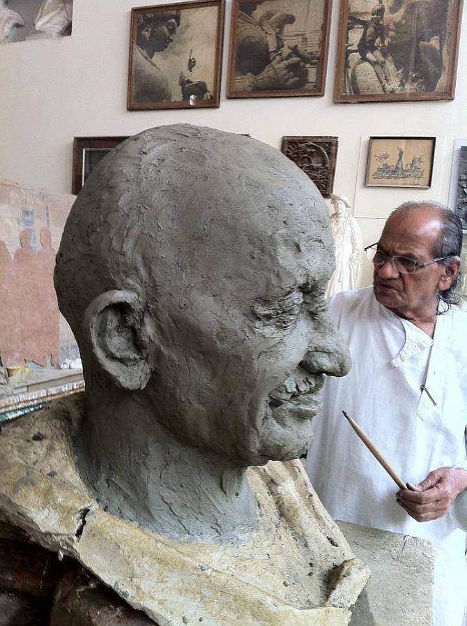 Sutar works on the sculpture of Mahatma Gandhi