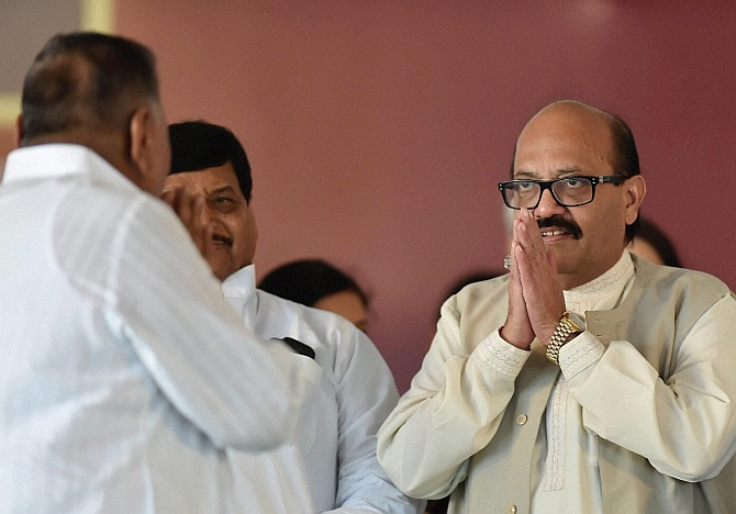 Samajwadi Party President Mulayam Singh Yadav exchanges greetings with partys expelled leader Amar Singh at the inauguration of Janeshwar Misra Park in Lucknow on Tuesday