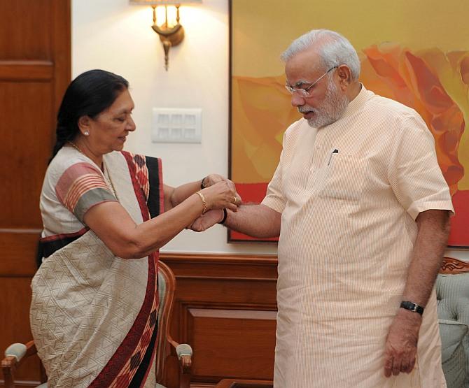 Anandiben Patel ties rakhi to Modi