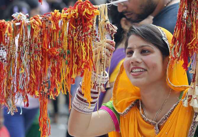 A woman shops at a stall selling Rakhis in Chandigarh