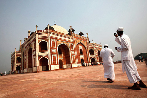A tourist takes pictures of Humayun's Tomb in New Delhi.
