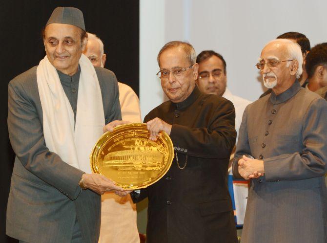 Congress veteran Karan Singh is given the award.