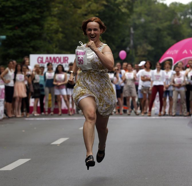 A participant runs in high-heels as she competes in the Stiletto Run in Bucharest.