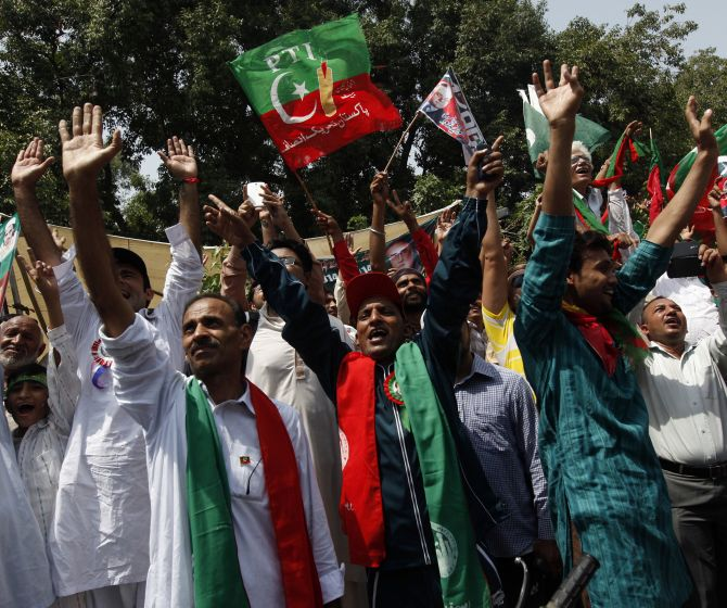 Supporters of cricketer-turned-opposition politician Imran Khan during the Freedom March in Lahore.