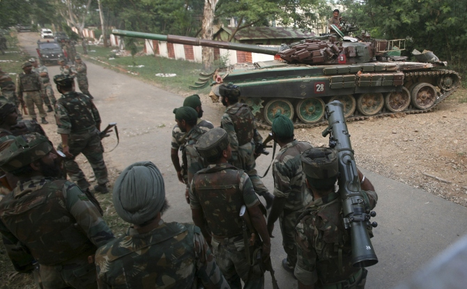 An Indian Army tank is deployed during an operation to flush out terrorists at an army camp in Mesar in Samba district.