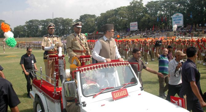 Jammu and Kashmir Chief Minister Omar Abdullah inspecting the parade during Independence Day function at Bakshi Stadium in Srinagar.