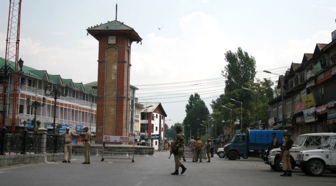 Security personnel stand guard at Lal Chowk