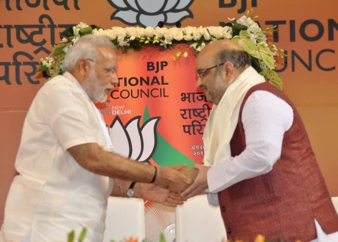 PM Modi congratulates Amit Shah after he is made BJP's president