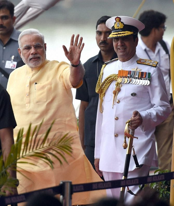 PM Narendra Modi along with Admiral RK Dhowan, Chief of Naval Staff, during the commissioning ceremony of INS Kolkata.