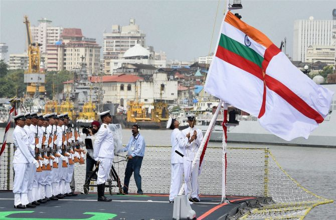 Naval officers leading the commissioning ceremony of INS Kolkata (D63) the lead ship of the Kolkata-class guided-missile destroyers at the Naval Dockyard