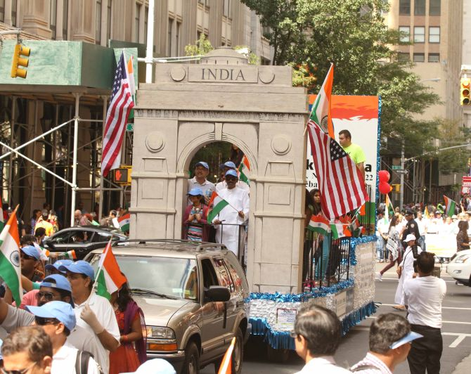A flotilla with the replica of India Gate travels through down the streets of New York city.