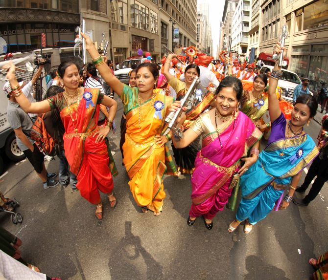 Lavani dancers take centre stage during the parade. The women also danced during the event.