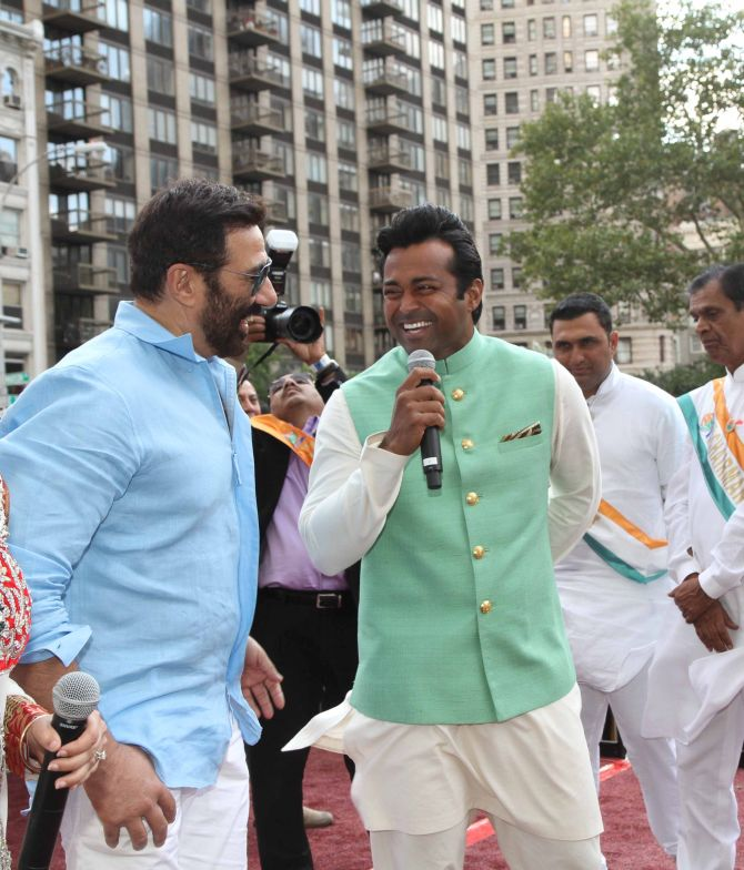 Tennis player Leander Paes shares a laugh with Sunny Deol.