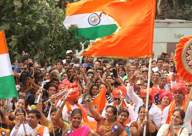 The Indian flag flew high and proud in New York on Sunday and thousands took part in the parade and waved the Indian flag.