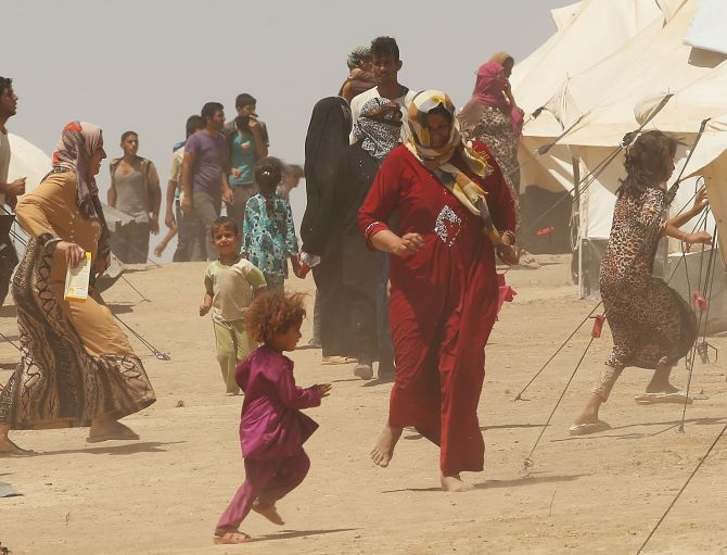 Desperate Iraqis at the Khazair displacement camp for those caught-up in the fighting