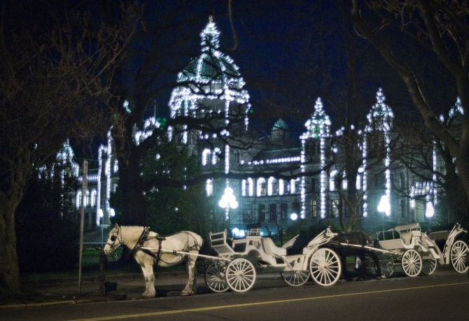 A horse-drawn carriage outside the British Columbia Legislature in Victoria, British Columbia.