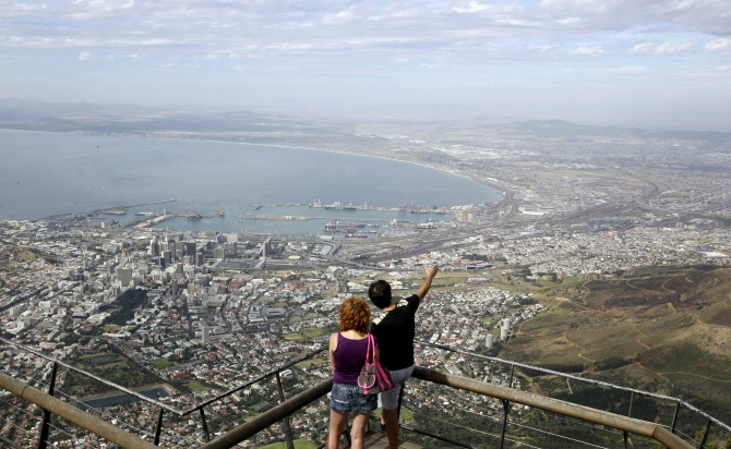Visitors enjoy the view over the city of Cape Town from the top of Table Mountain, one of South Africa's biggest tourist attractions above Cape Town.