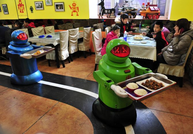Into the future! Robots COOK up a storm in this restaurant