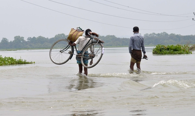 PHOTOS: Flood fury affects lakhs in Assam, UP and Bihar