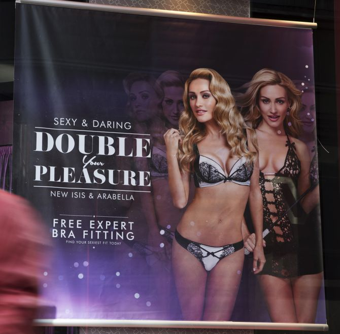 an advertisement displayed in the window of an Ann Summers store in London.