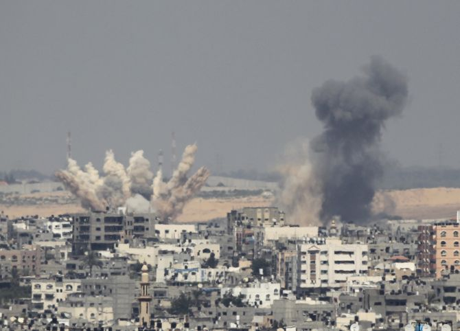 Smoke rises following what witnesses said were Israeli air strikes in Gaza. Israeli aircraft bombed the Gaza Strip on Saturday and Palestinian militants fired rockets at the Jewish state.
