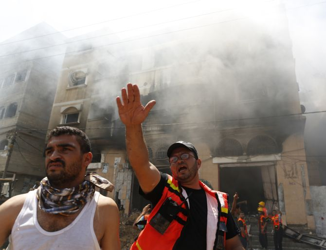 A Palestinian firefighter reacts at the scene of what witnesses said was an Israeli air strike on a house in Gaza City.