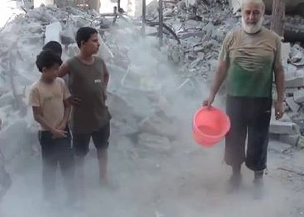 A man completes the Rubble Bucket challenge