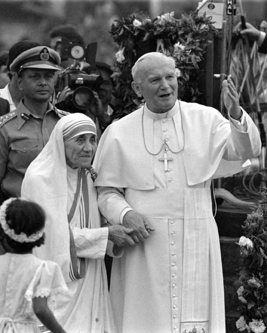 Pope John Paul II holds hands with Mother Teresa after visiting the Casa del Cuore Puro, Mother Teresa's home for the destitute and dying in Kolkata in this February 3, 1986 file photo.