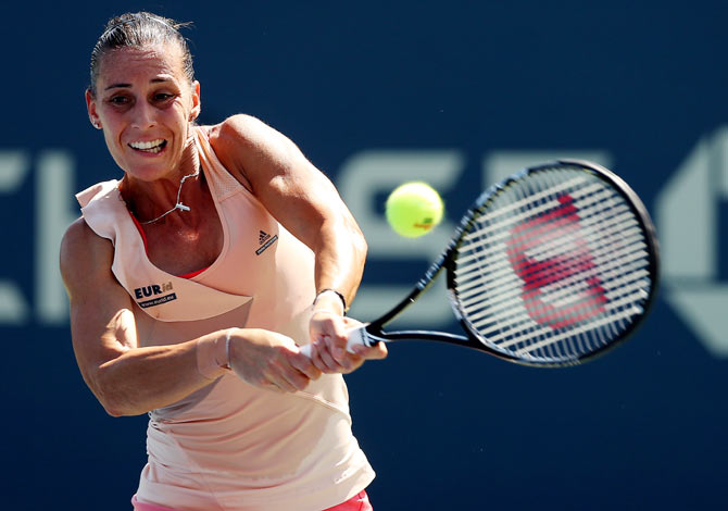 Flavia Pennetta of Italy returns a shot to Shelby Rogers of the United States on Thursday
