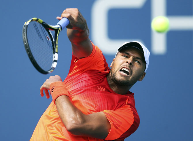 Jo-Wilfried Tsonga of France hits a smash against Aleksandr Nedovyesov of Kazakhstan during their US Open match on Thursday