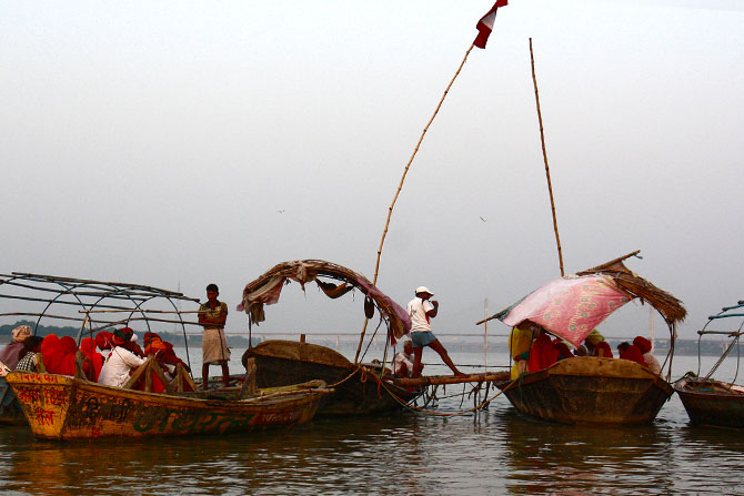 Boats connected by a platform at the Sangam Triveni