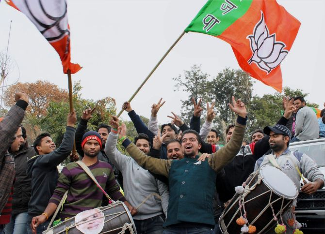 BJP workers celebrate after the election results in Jammu on Tuesday, December 23. Photograph: PTI